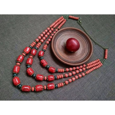 Necklace Patsyorka of ceramic beads red 3 threads