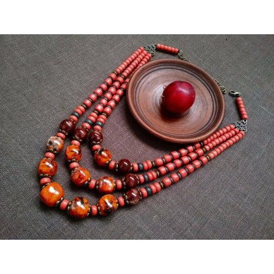 Necklace Patsyorka of lampwork beads orange/red 3 threads